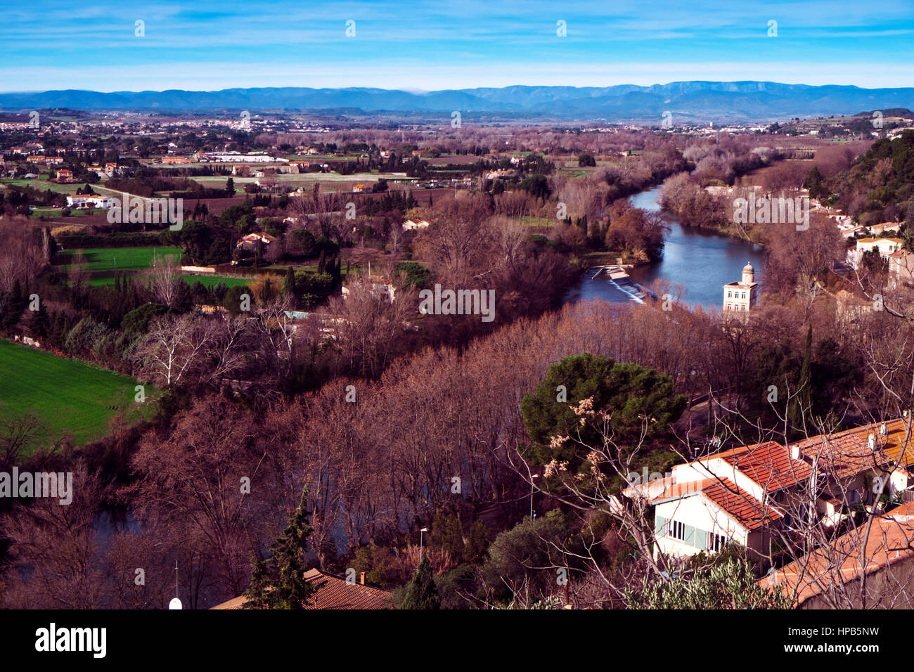 a view of the Orb River bordering Beziers, France, in winter - Stock Image