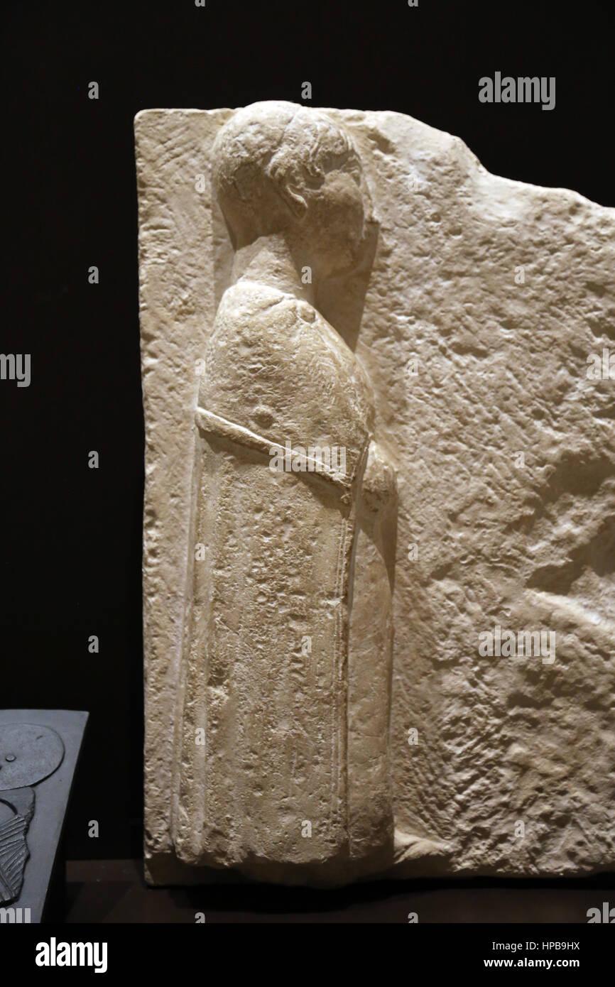 Iberian ashlars. Woman with tunic. Osuna 2nd century BC.Osuna (Seville). Spain. Ibero-roman. National Archaeological - Stock Image