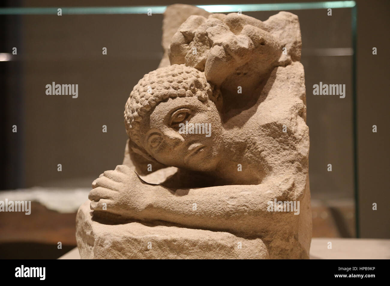 Iberian ashlars. Osuna group B. Man attacked by a lion. Limestone. Early 1st century BC. Osuna (Seville). Spain. - Stock Image
