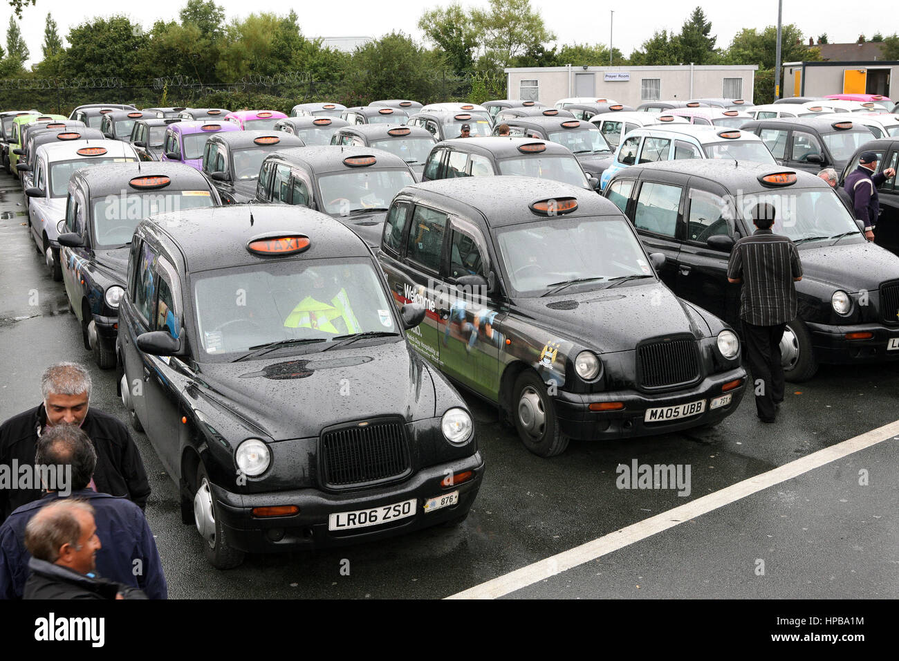 Taxis remained parked up near Manchester Airport as their drivers go on strike. - Stock Image