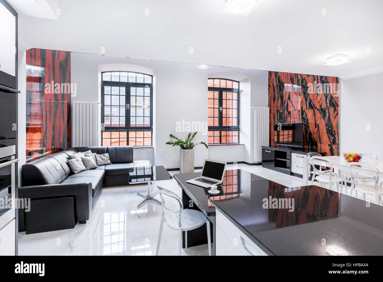 Modern designed living room and dining room with black and red wall ...