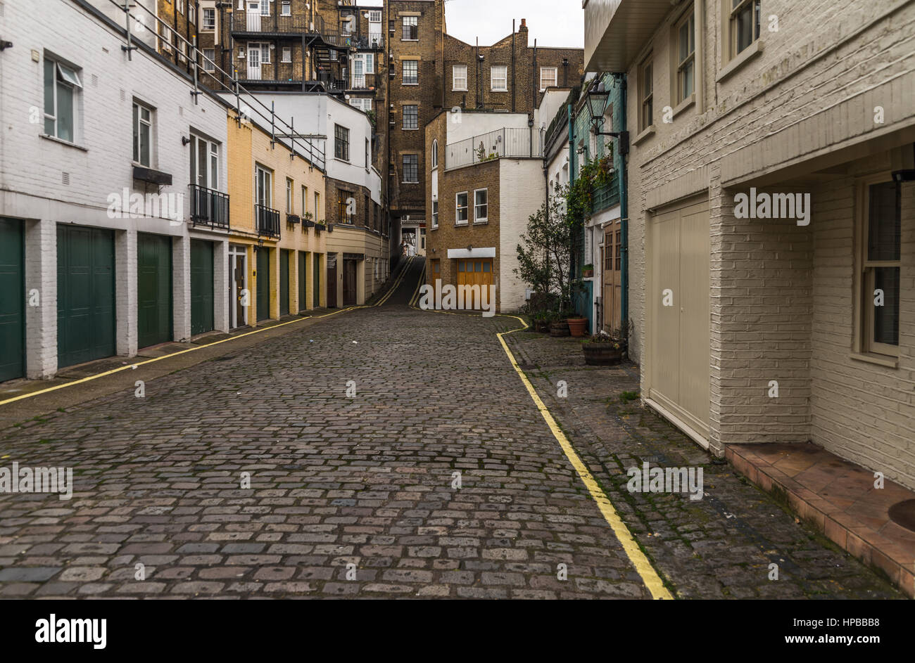 View on an interesting  street, characteristic buildings English quarter, the combination of low and high-rise buildings, Stock Photo