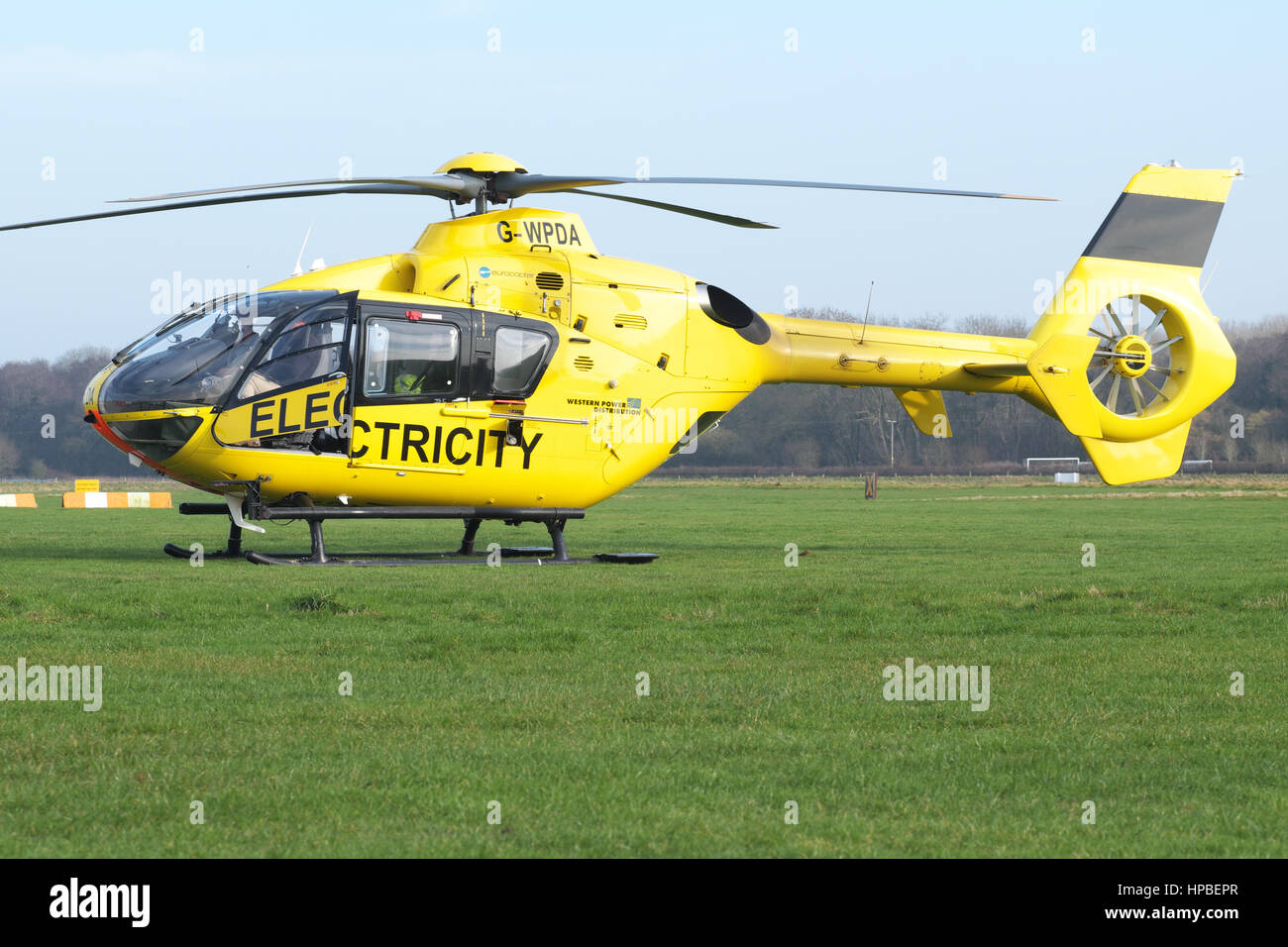 Eurocopter EC 135 helicopter used for electricity power supply checking by Western Power Distribution WPD in UK - Stock Image