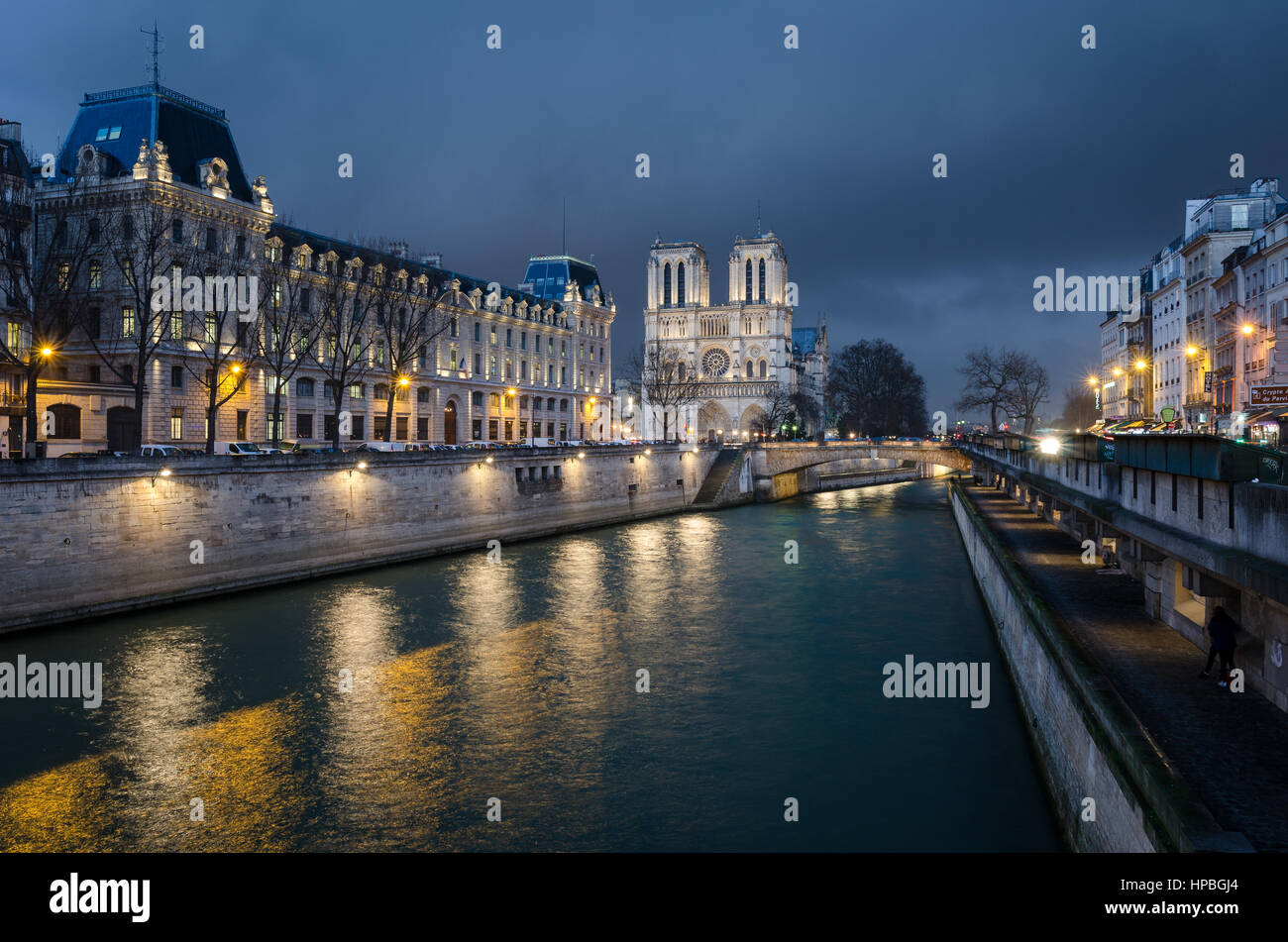 Notre-Dame de Paris and Seine river at blue hour - Stock Image