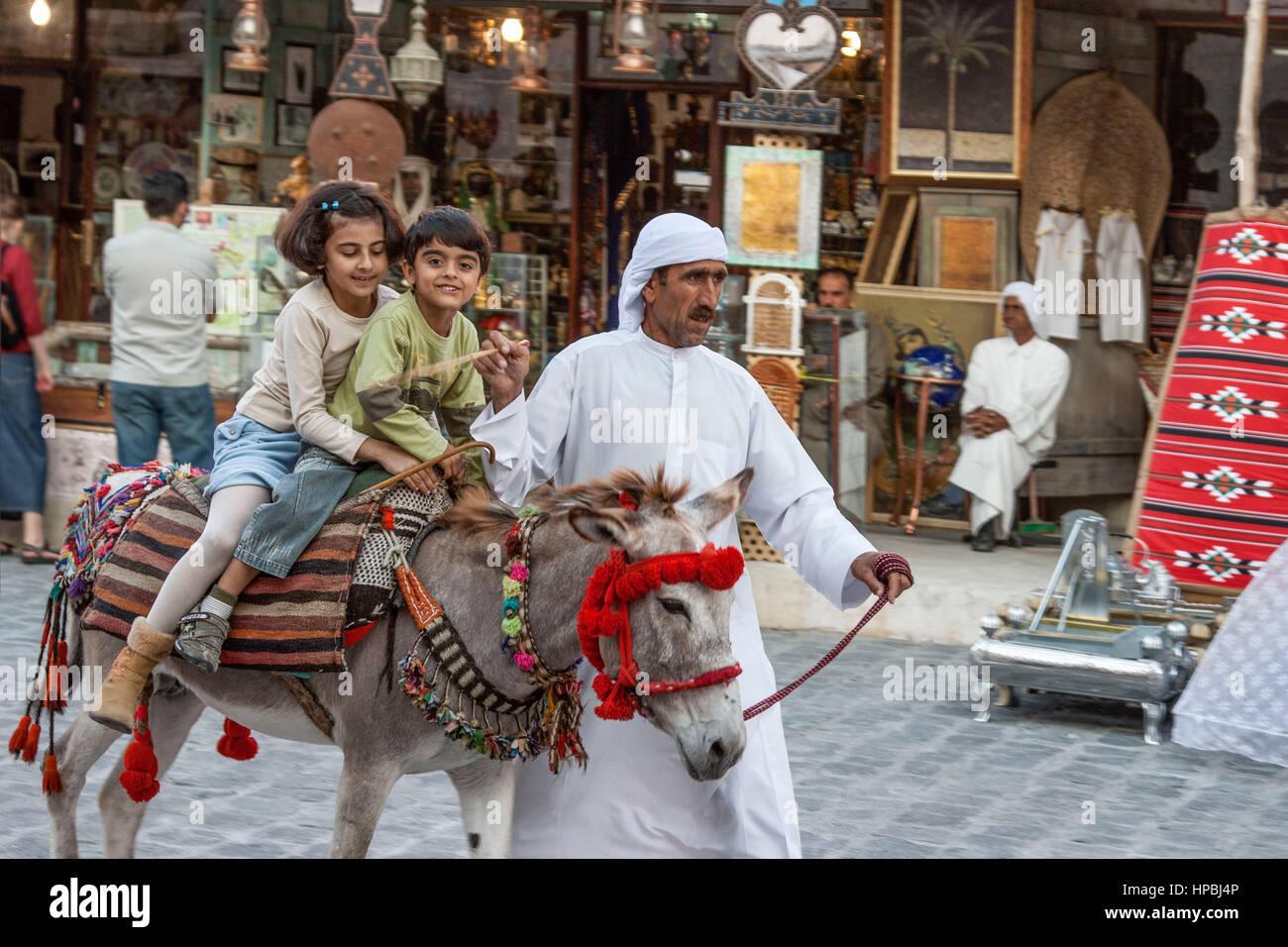 Qatar Doha Souk , children on donkey - Stock Image