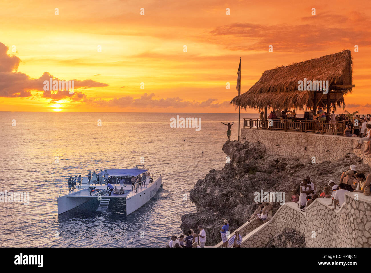 Ricks Cafe open air bar , Rick´s viewpoint at sunset, Catamaran, nightlife, Negril Jamaica, - Stock Image