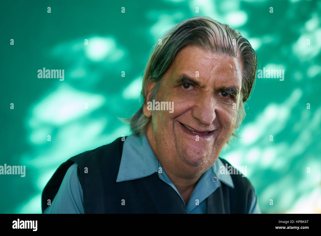 Old hispanic real people from Cuba with feelings and emotions, portrait of funny senior caucasian man smiling, laughing - Stock Image