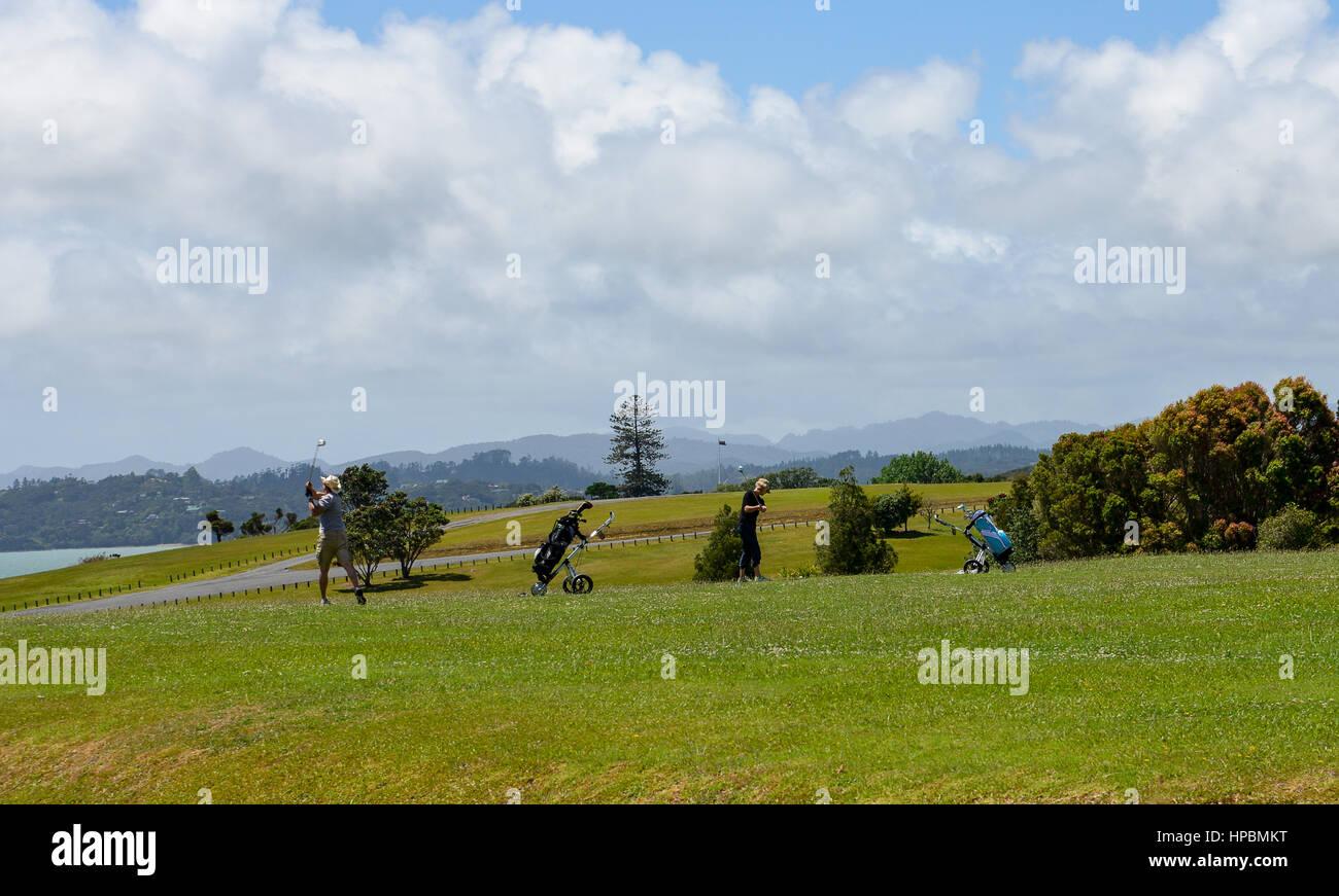 People play golf at Waitangi Golf Club, New Zealand - Stock Image