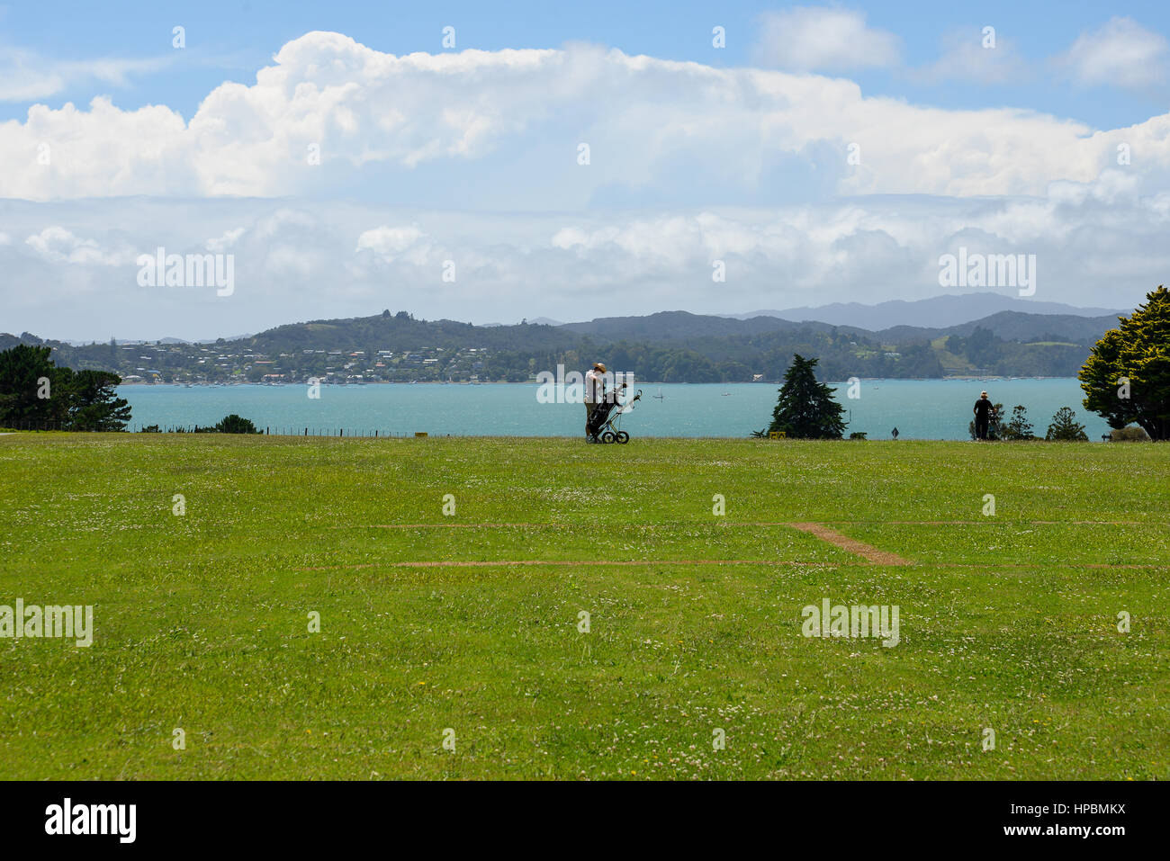 Playing golf at Waitangi Golf Club with a view of Bay of Islands, New Zealand - Stock Image