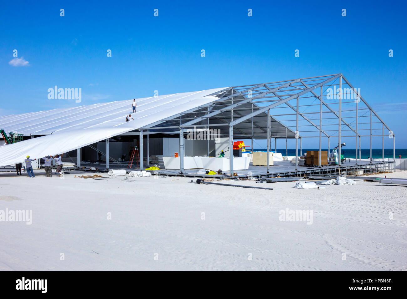 Miami Beach Florida Lummus Park Art Basel Week sand event tent assemble disassemble temporary building frame metal - Stock Image