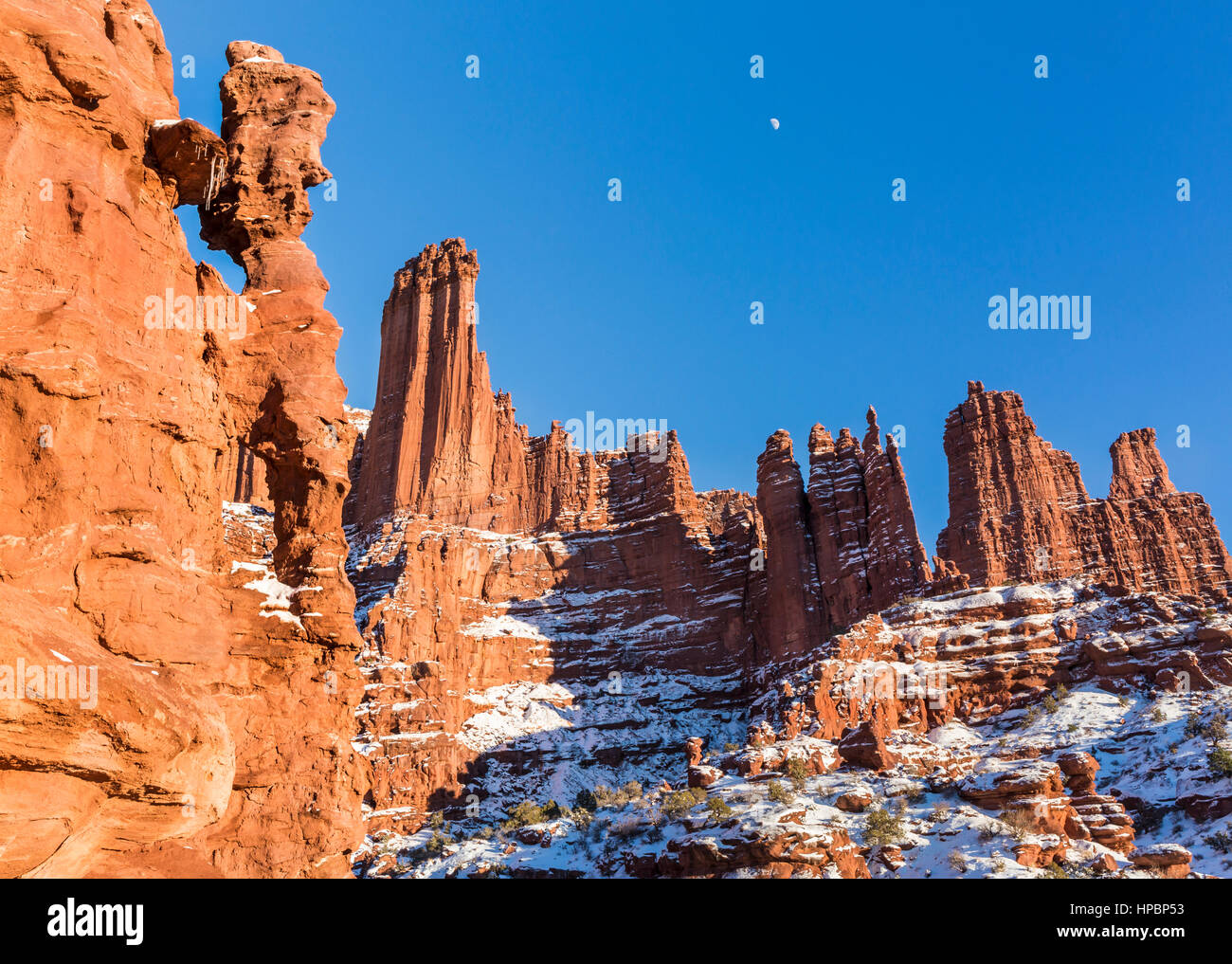 The Titan Tower and jug handle arches, part of the Fisher Towers rock formations near Moab, Utah - Stock Image