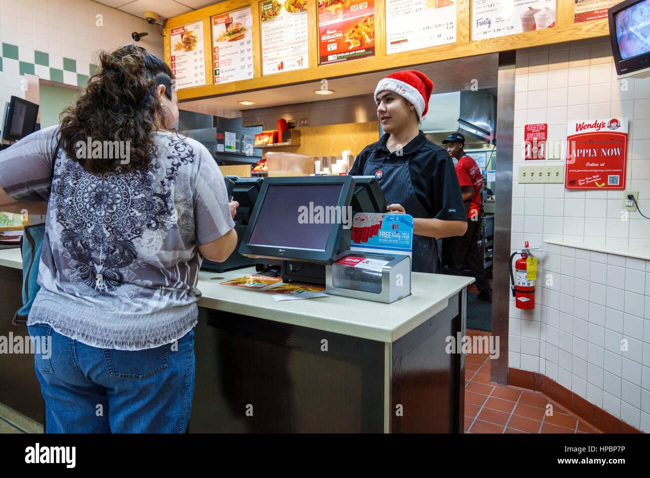 homestead florida wendys restaurant hamburger fast food cashier customer woman boy teen counter ordering job employee wearing santa hat