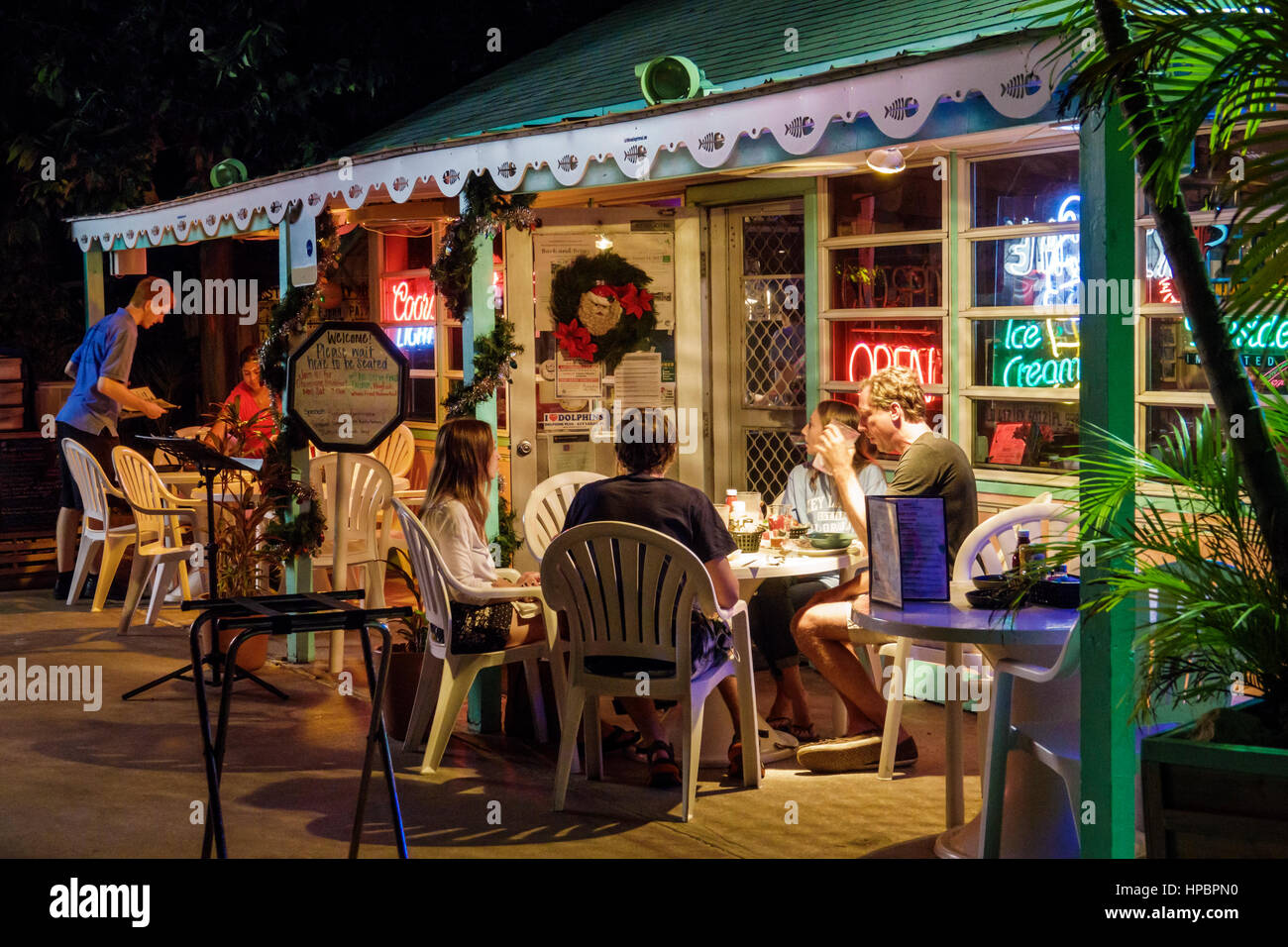 Key Largo Florida Upper Florida Keys Mrs. Mac's Kitchen restaurant seafood dining alfresco table porch man woman - Stock Image