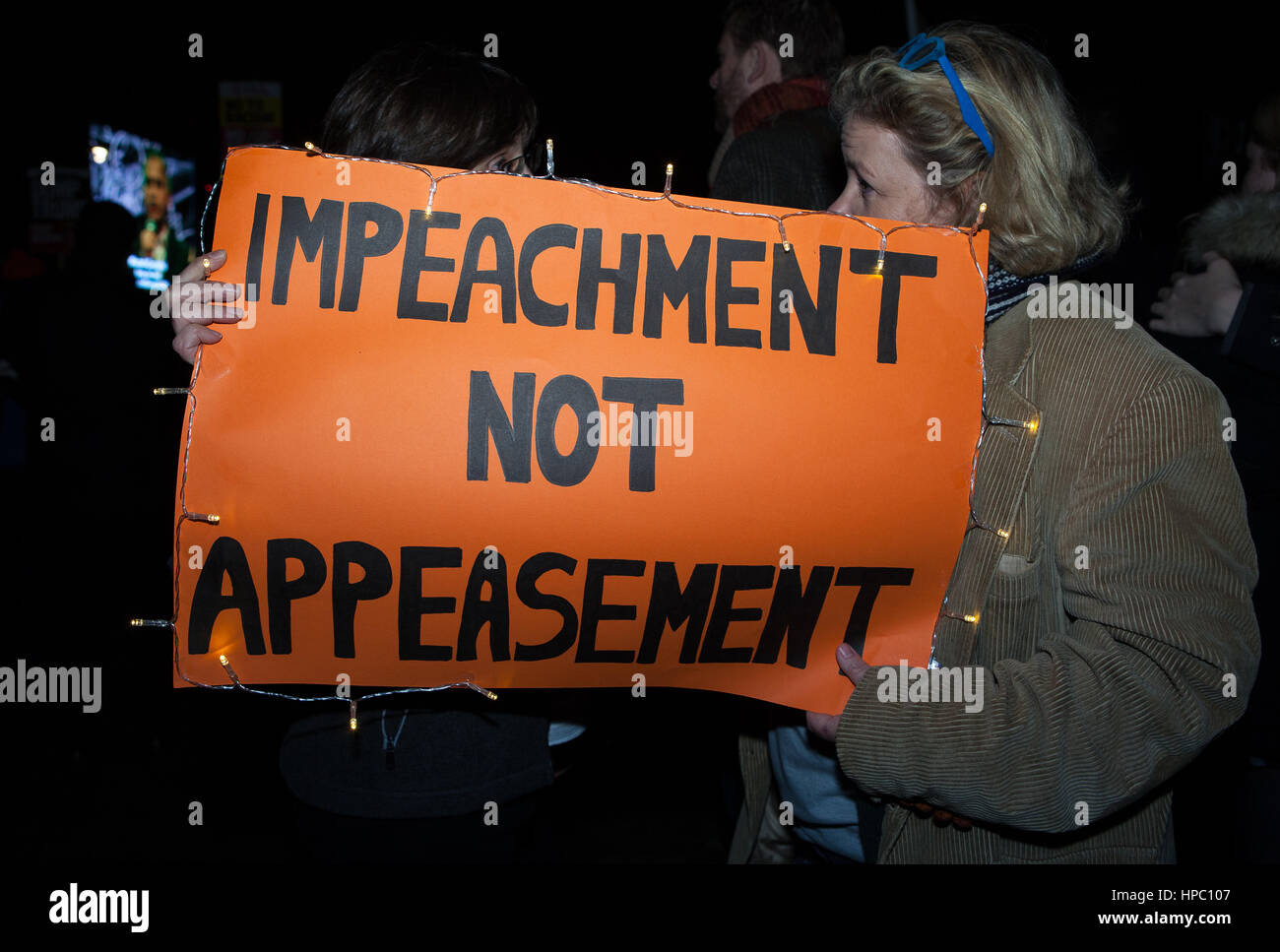 London, UK. 20th Feb, 2017. Protesters with a placard at an anti Trump demonstration at Parliament Square. Protesters - Stock Image
