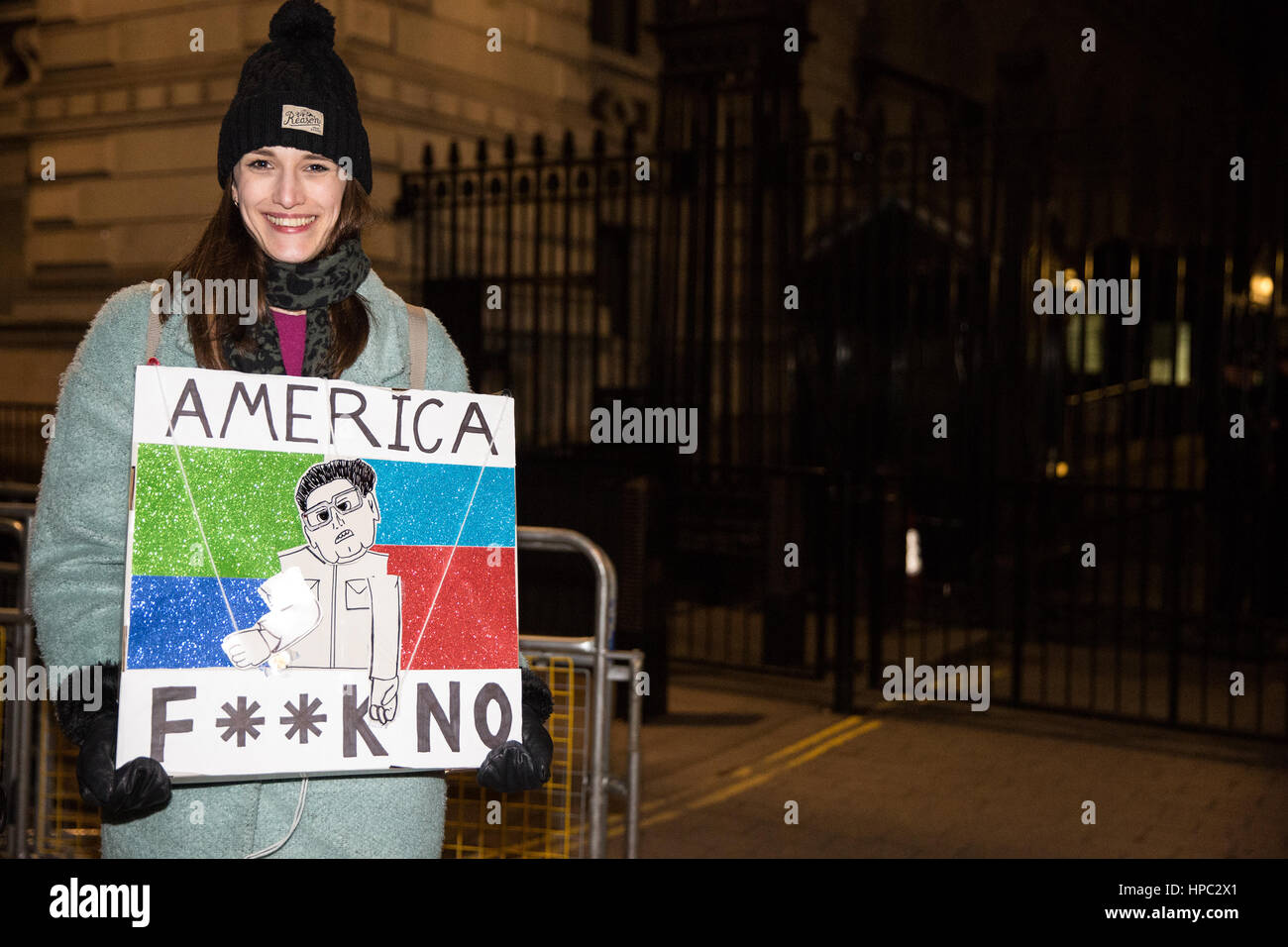 London, UK. 20th February, 2017. A demonstrator holds a sign outside Downing Street follwing the Stop Trump rally Stock Photo