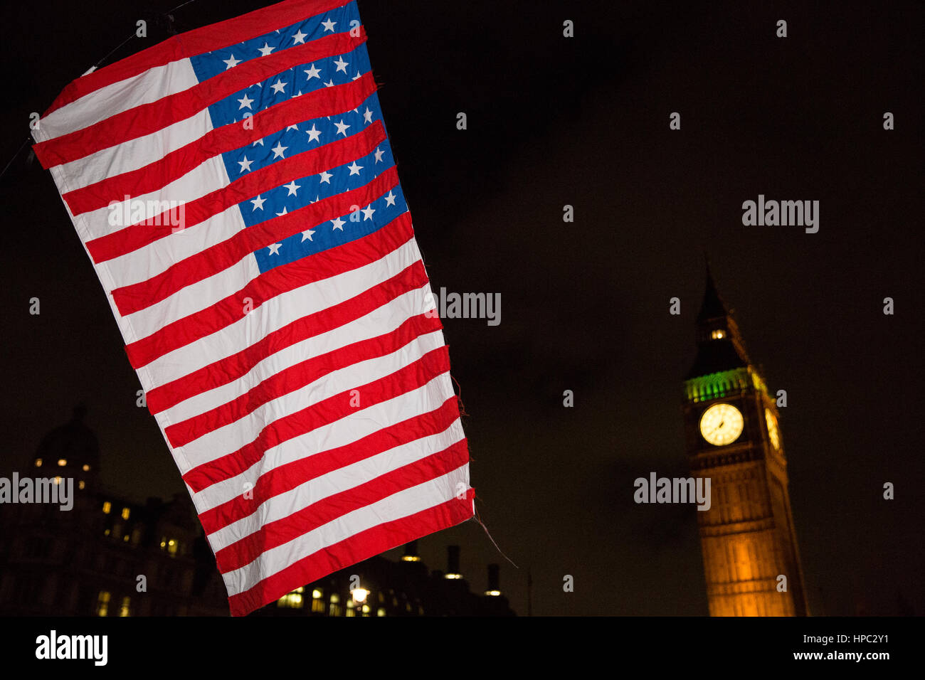 London, UK. 20th February, 2017. A stylised American flag waved by a demonstrator attending a Stop Trump rally in - Stock Image