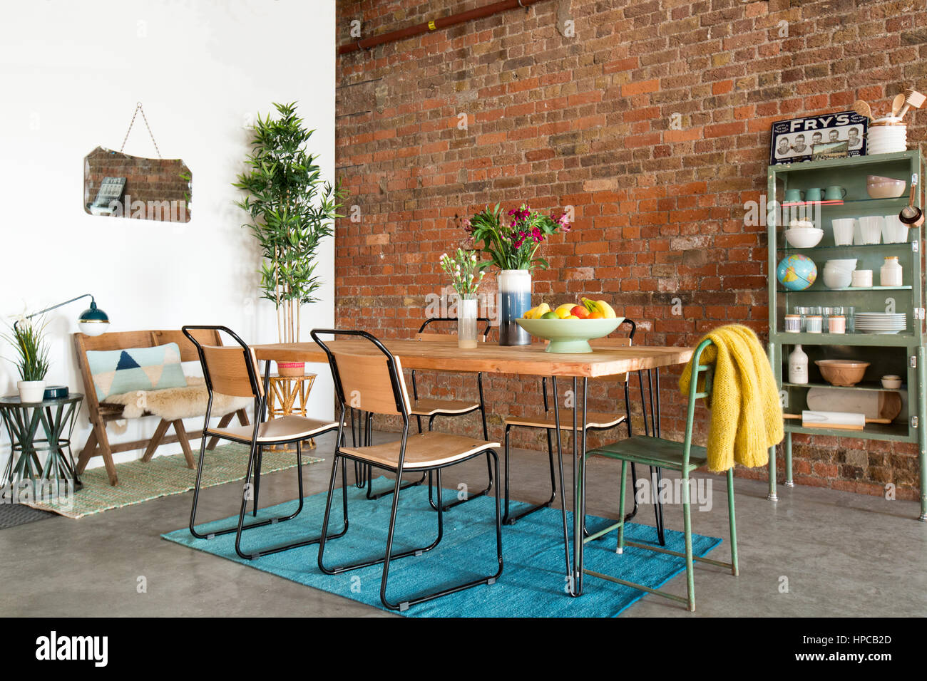 Dining Table And Chairs In A Large Urban Living Space With Exposed Stock Photo Alamy