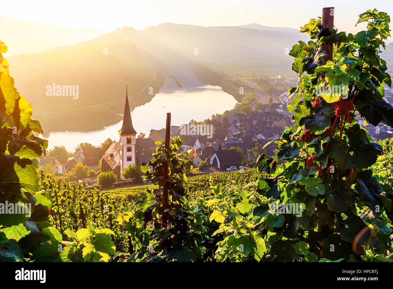 Sunrise at the moselle river bend over the village Bremm - Stock Image