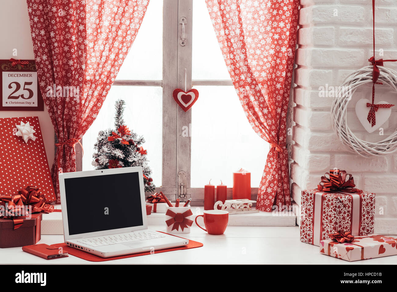 home interior with red christmas decorations calendar and laptop