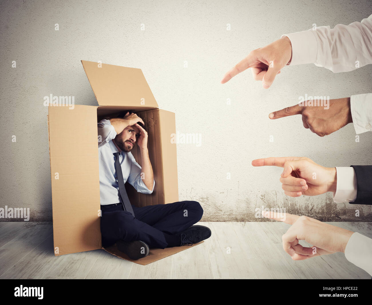 Guilty businessman indicated by colleagues - Stock Image