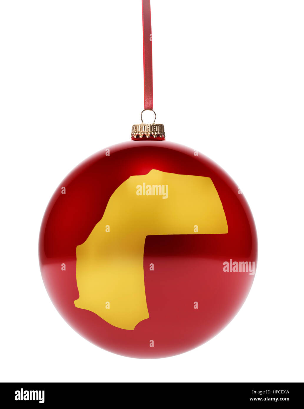 A hanging glossy red bauble with the golden shape of Western Sahara.(series) - Stock Image