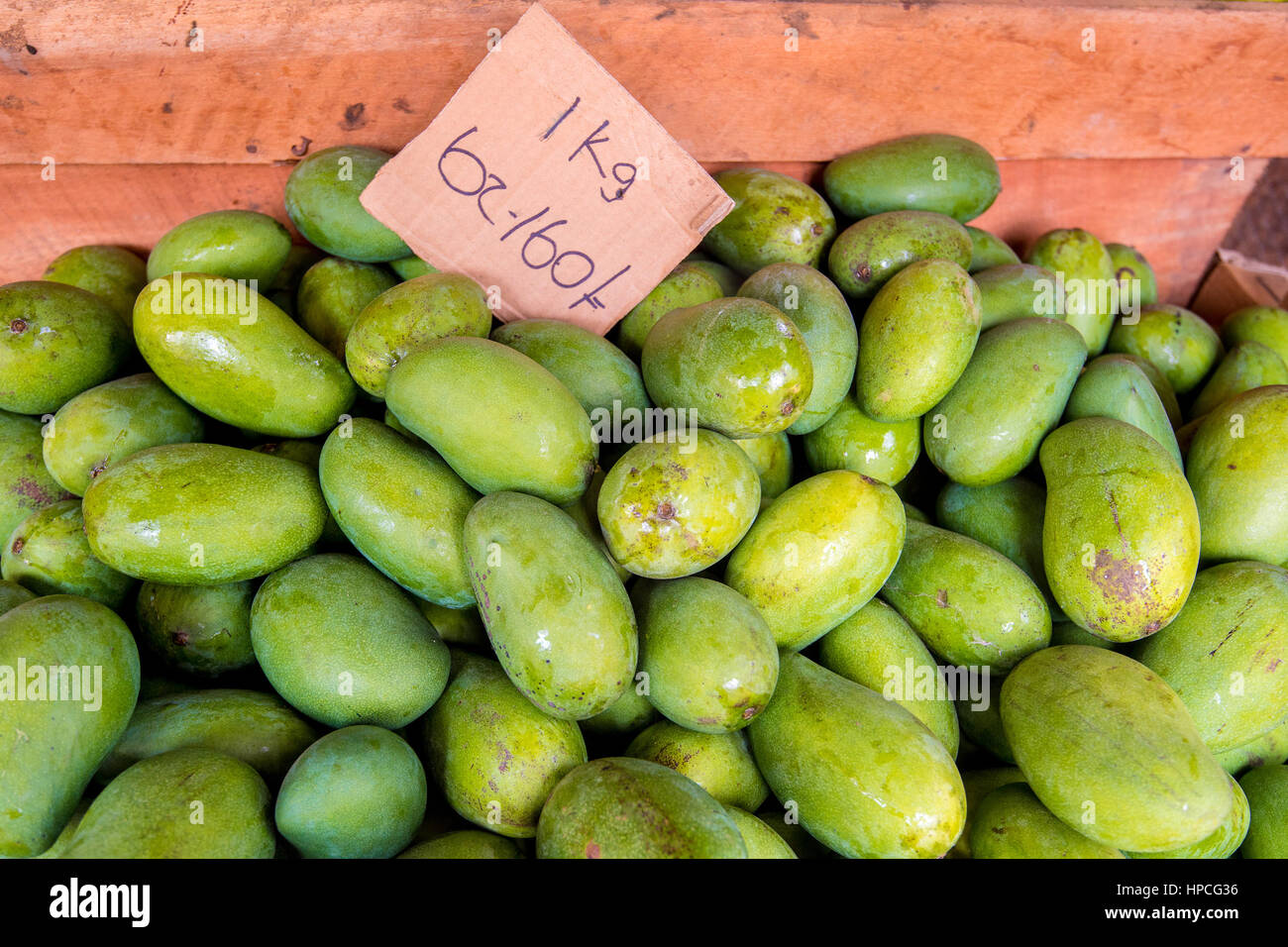 Green mango at marketplace - Stock Image
