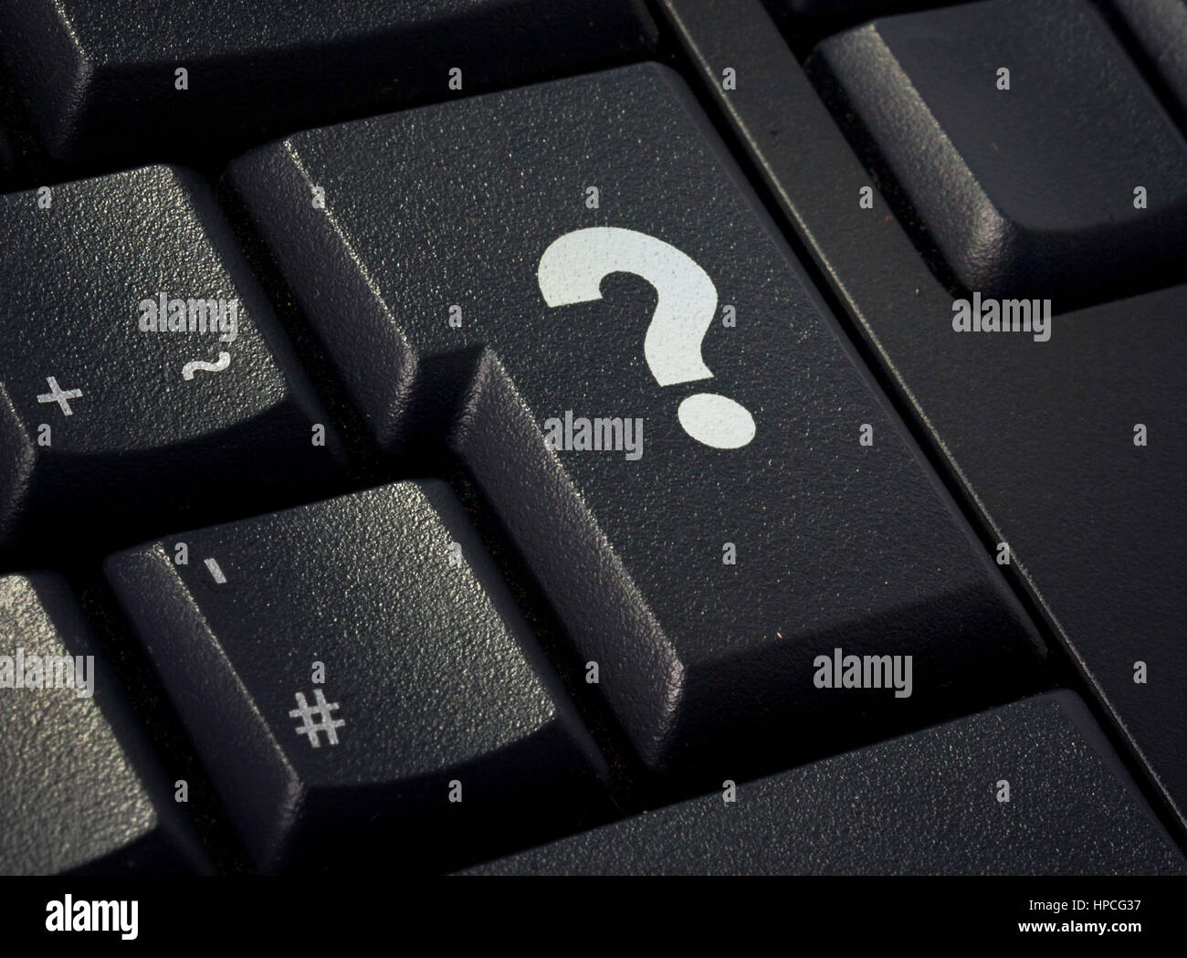 Return key of a black keyboard with the shape of a question mark imprinted .(series) - Stock Image