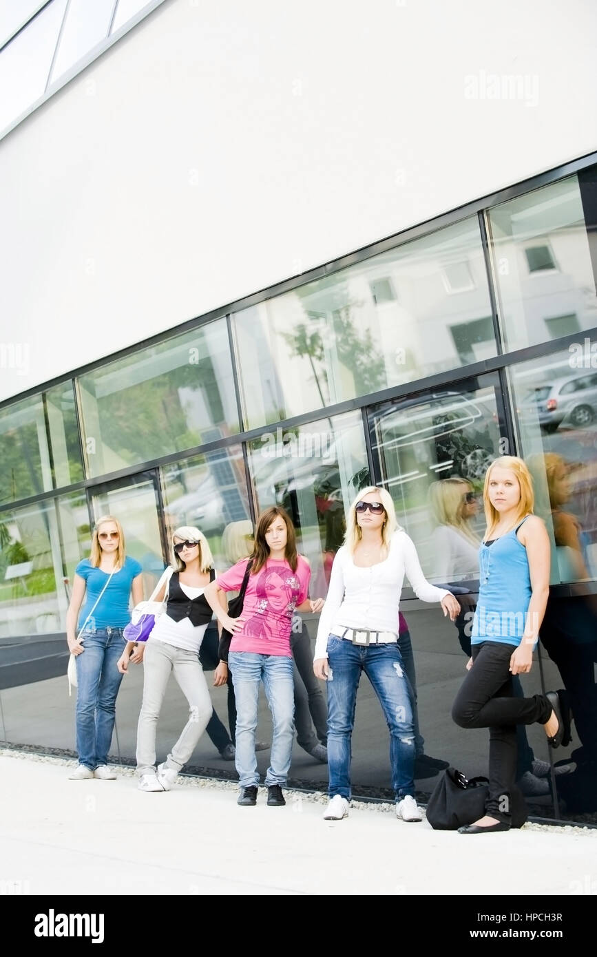 five girls infront of school - Stock Image