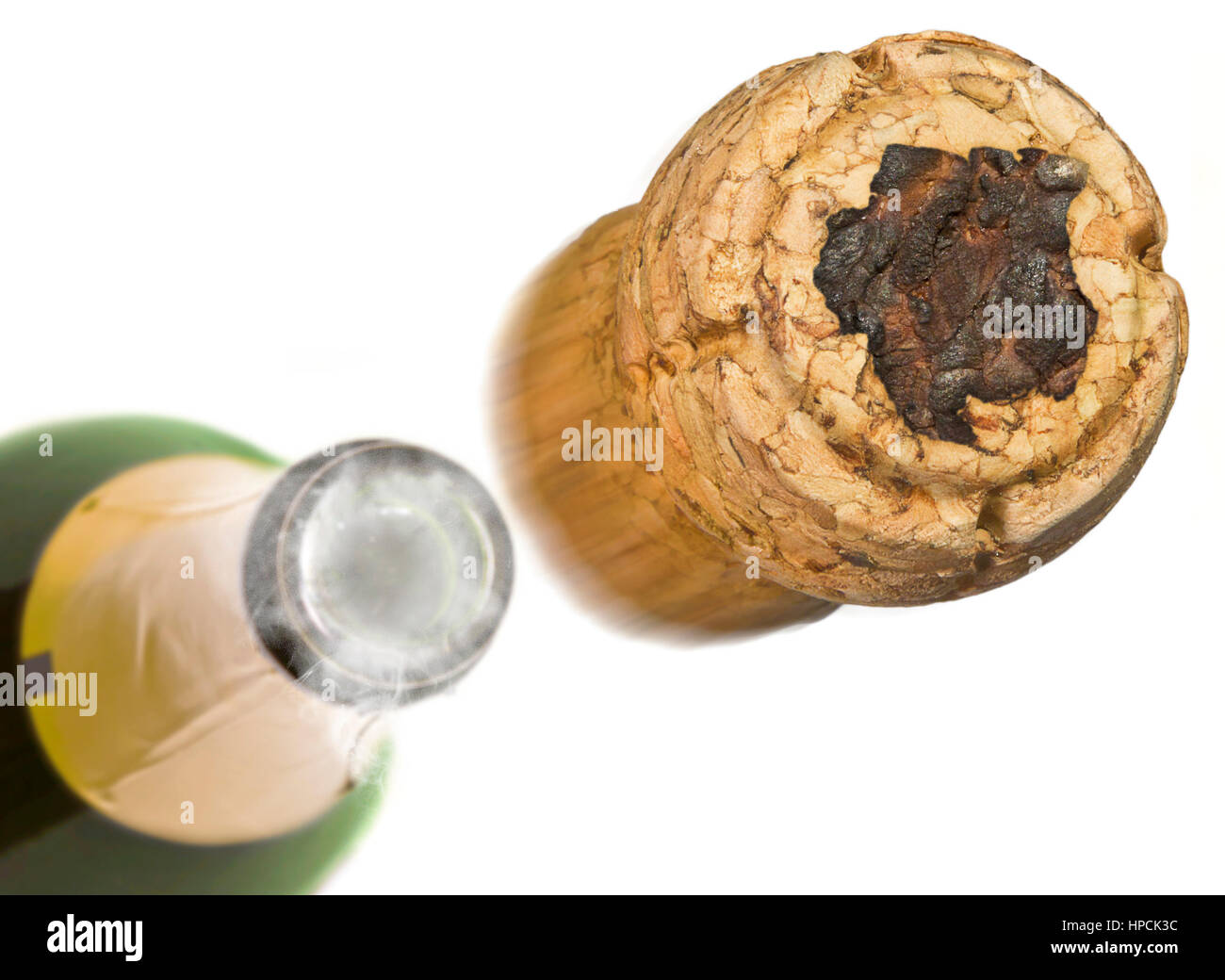 Champagne cork with the shape of Suriname burnt in and bottle of champagne in the back.(series) - Stock Image