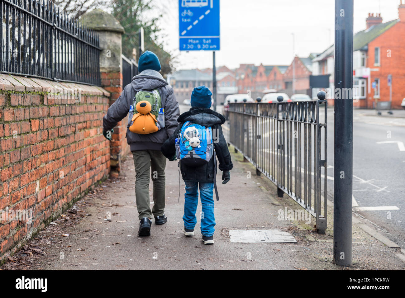 Travel concept of two boys with backpacks going forward. - Stock Image
