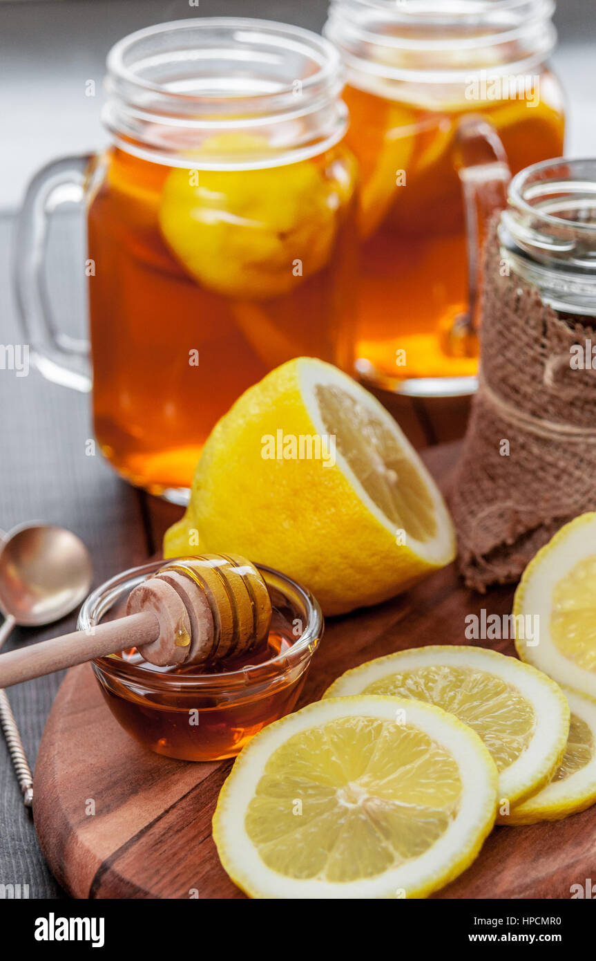 Hot tea with lemon and honey, good treat to have vitamins and strong immunity. - Stock Image
