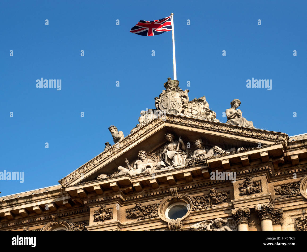 Union Jack Flying over the Pediment at the Maritime Museum at Queen Victoria Square Hull Yorkshire England - Stock Image