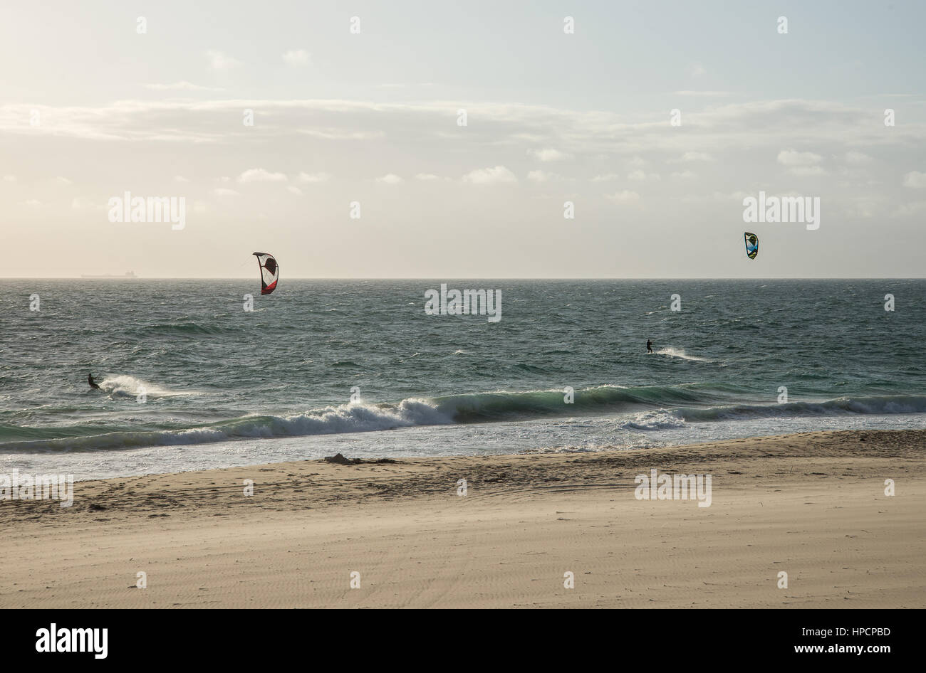Two men kitesurfing on the beach in Indian ocean in Perth, Western Australia Stock Photo