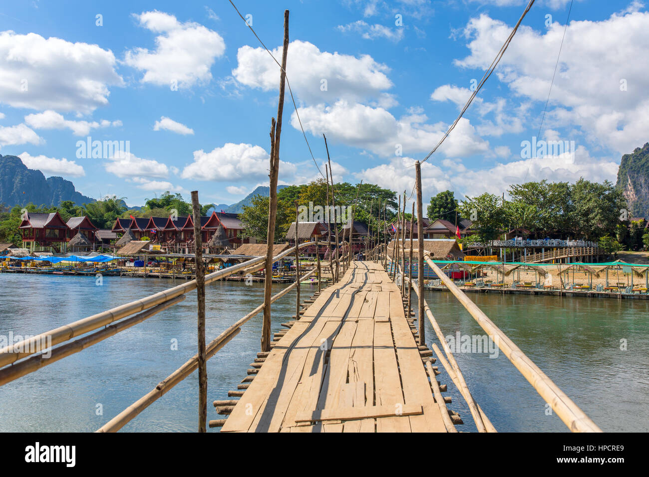 Wooden bridge across Nam Song river at Vang Vieng, Laos - Stock Image