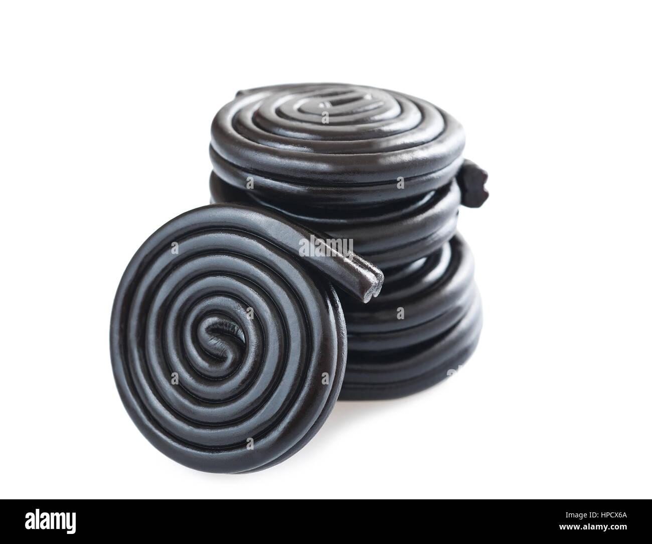 licorice wheels isolated on white - Stock Image