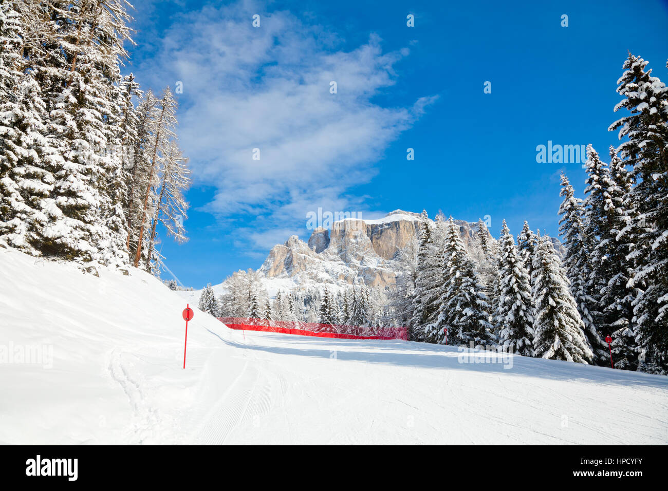 Red slope in Sella Ronda ski route, Dolomites, Italy Stock Photo
