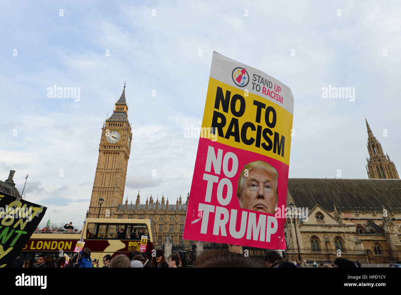 An anti racism, anti Donald Trump placard outside the Palace of Westminster, London, during a demonstration rally - Stock Image