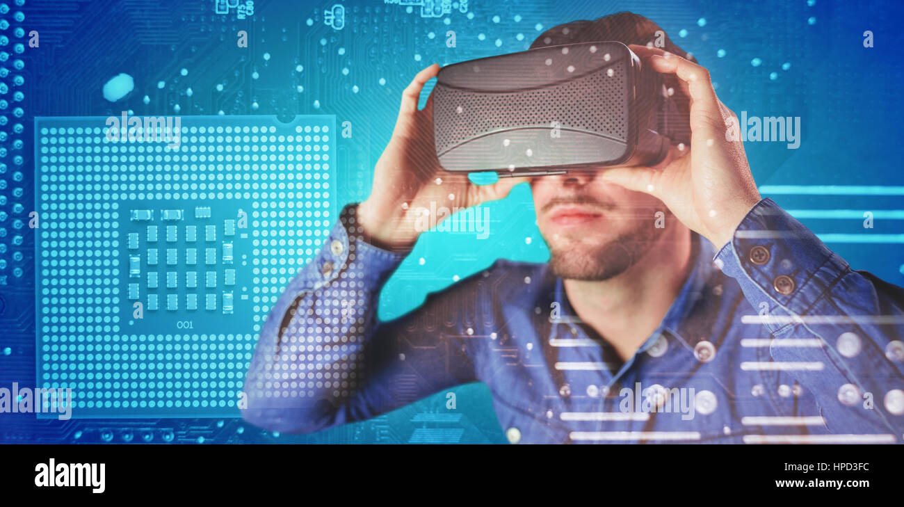 Man using an oculus against micro parts in computer chip - Stock Image