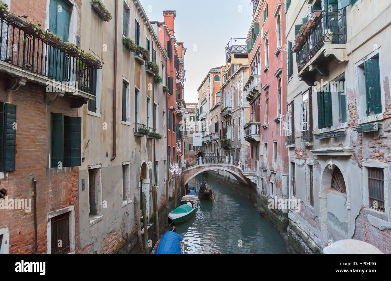 A view of gondolas and the Venice canals in Italy. - Stock Image