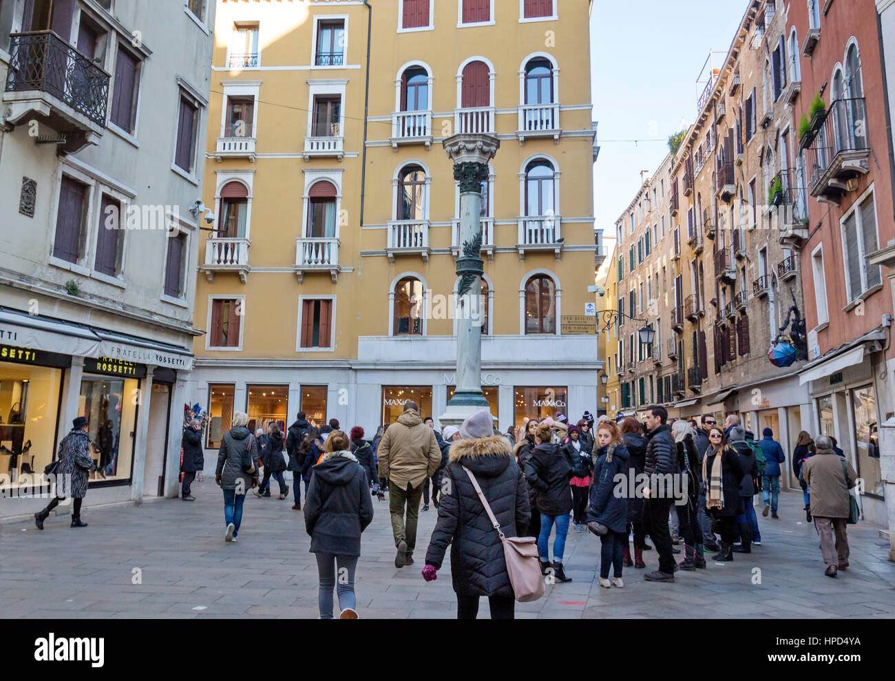 Tourists walking around in Venice, Italy. - Stock Image
