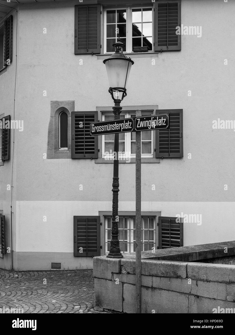 Grossmunsterplatz and Zwingliplatz street signs in Zurich, Switzerland. Black and white photography. - Stock Image
