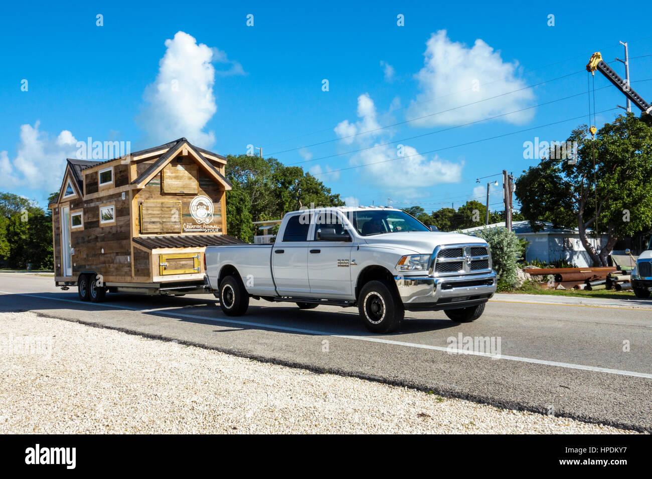 Key Largo Florida Upper Florida Keys little house moving transporting hauling trailer Route 1 Overseas Highway Stock Photo