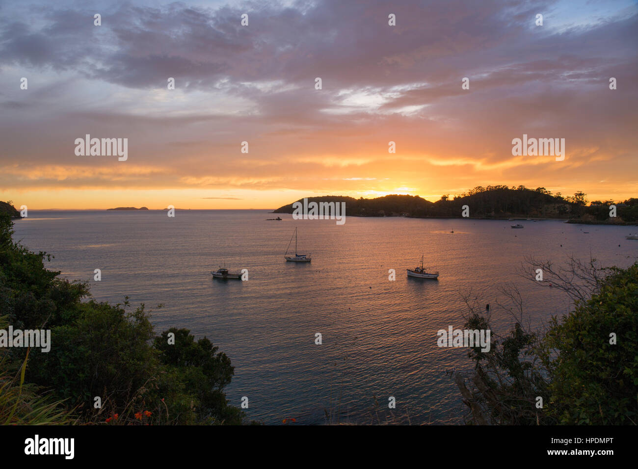 Oban, Stewart Island, Southland, New Zealand. View over Halfmoon Bay at sunrise. - Stock Image