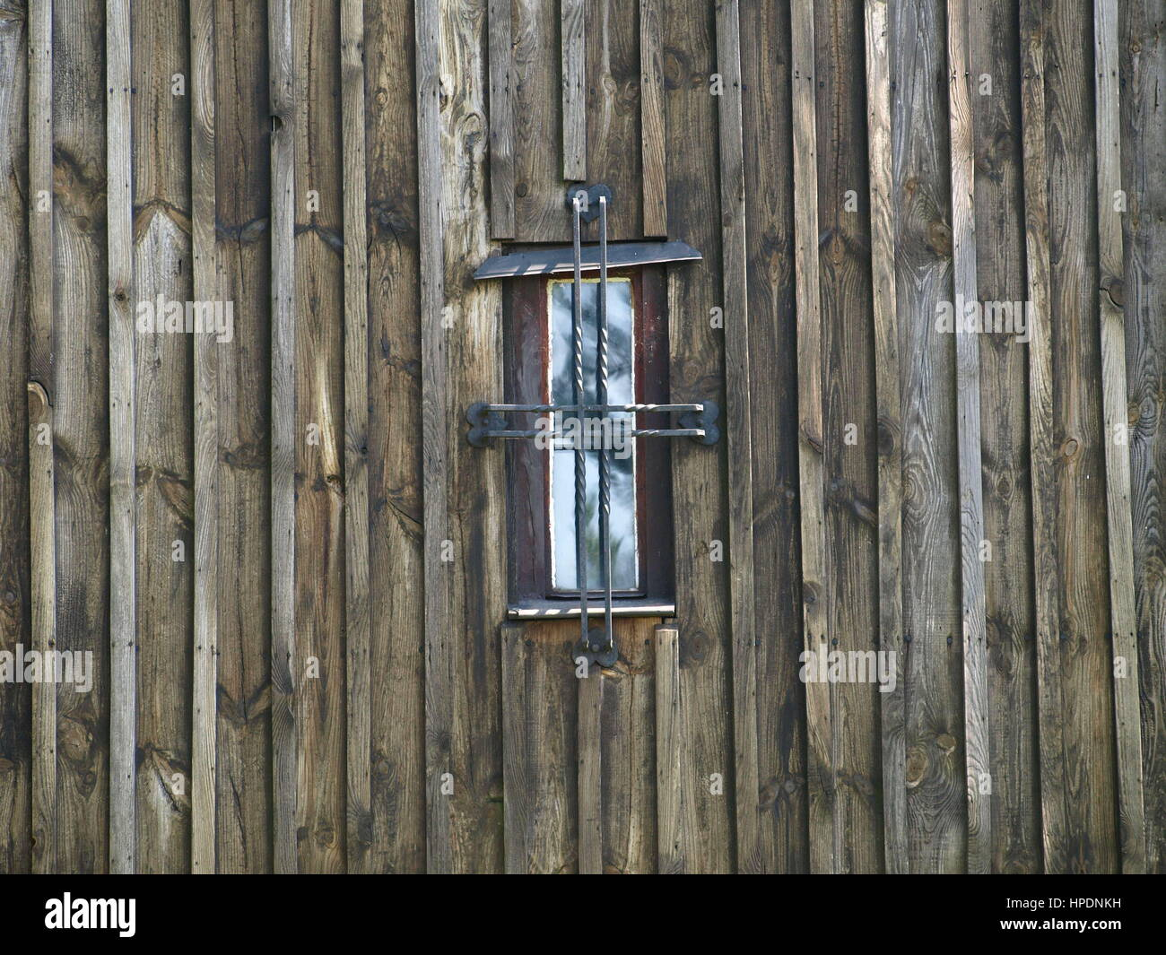 Window in old wooden building - Stock Image