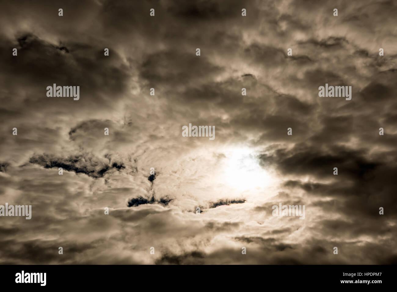 Dark foreboding sky during solar eclipse - Stock Image