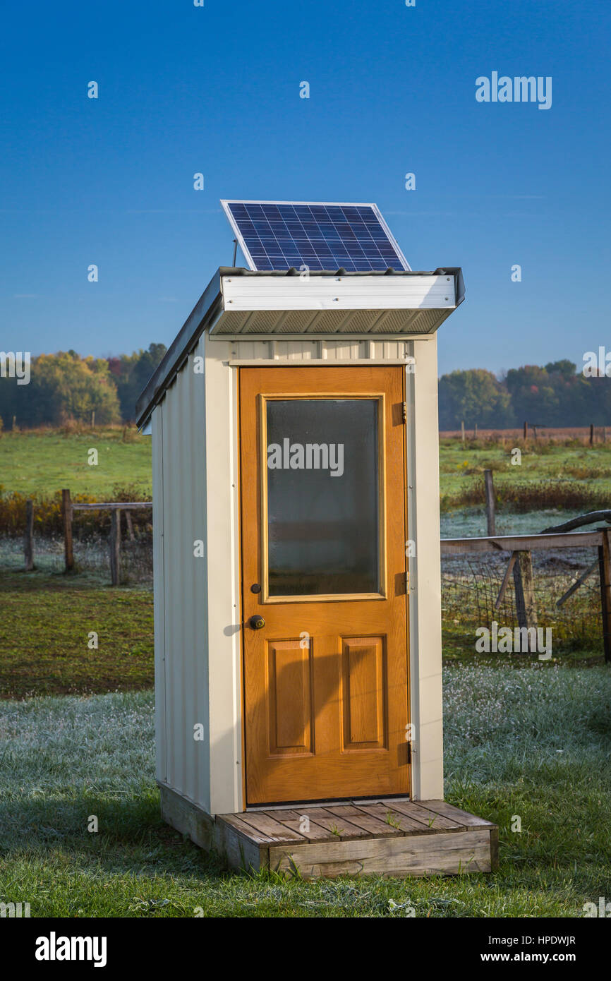 A Rural Telephone Booth With A Solar Panel In Amish