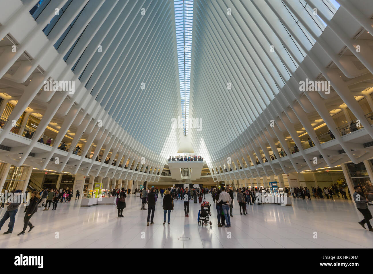 Shoppers and tourists enjoy the view inside the Oculus and stores in the Westfield World Trade Center mall in New - Stock Image