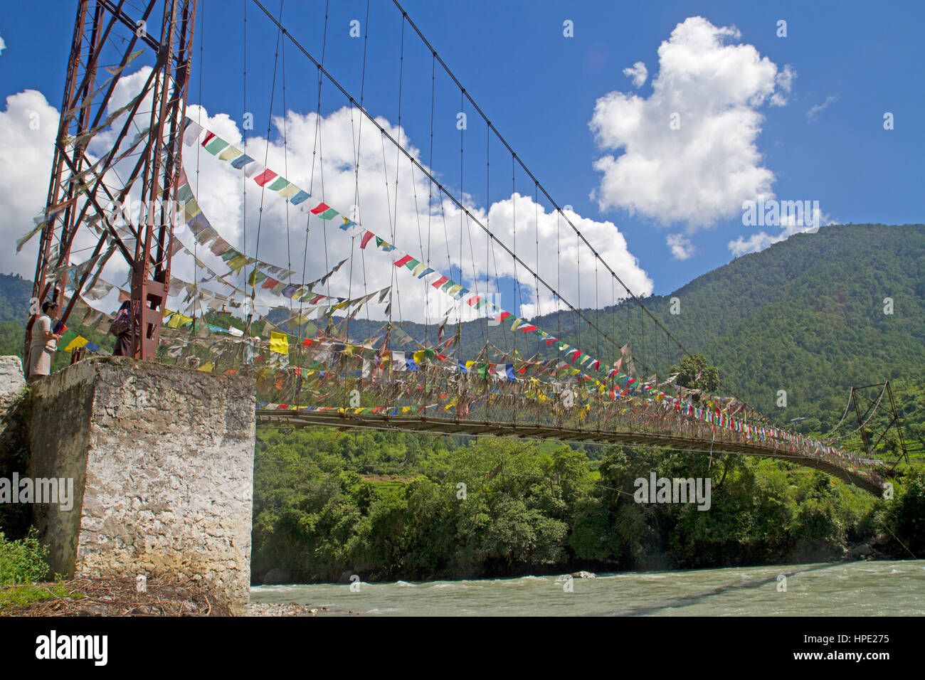 Prayer flags on a footbridge over the Mo Chu River at Punakha - Stock Image