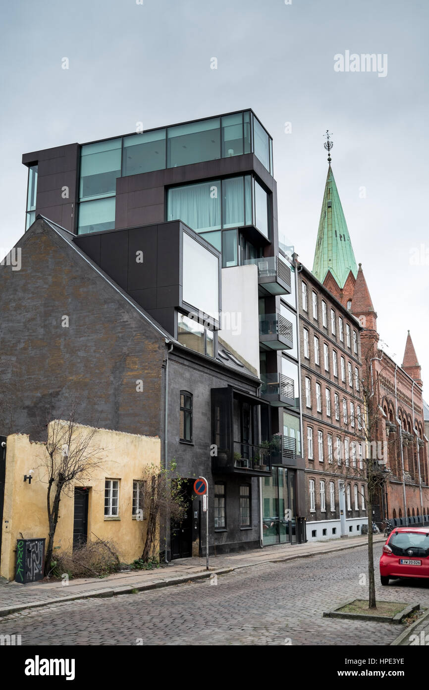 Street scene with modern house and traditional buildings side by side on Stokhusgade, Copenhagen urban living Stock Photo
