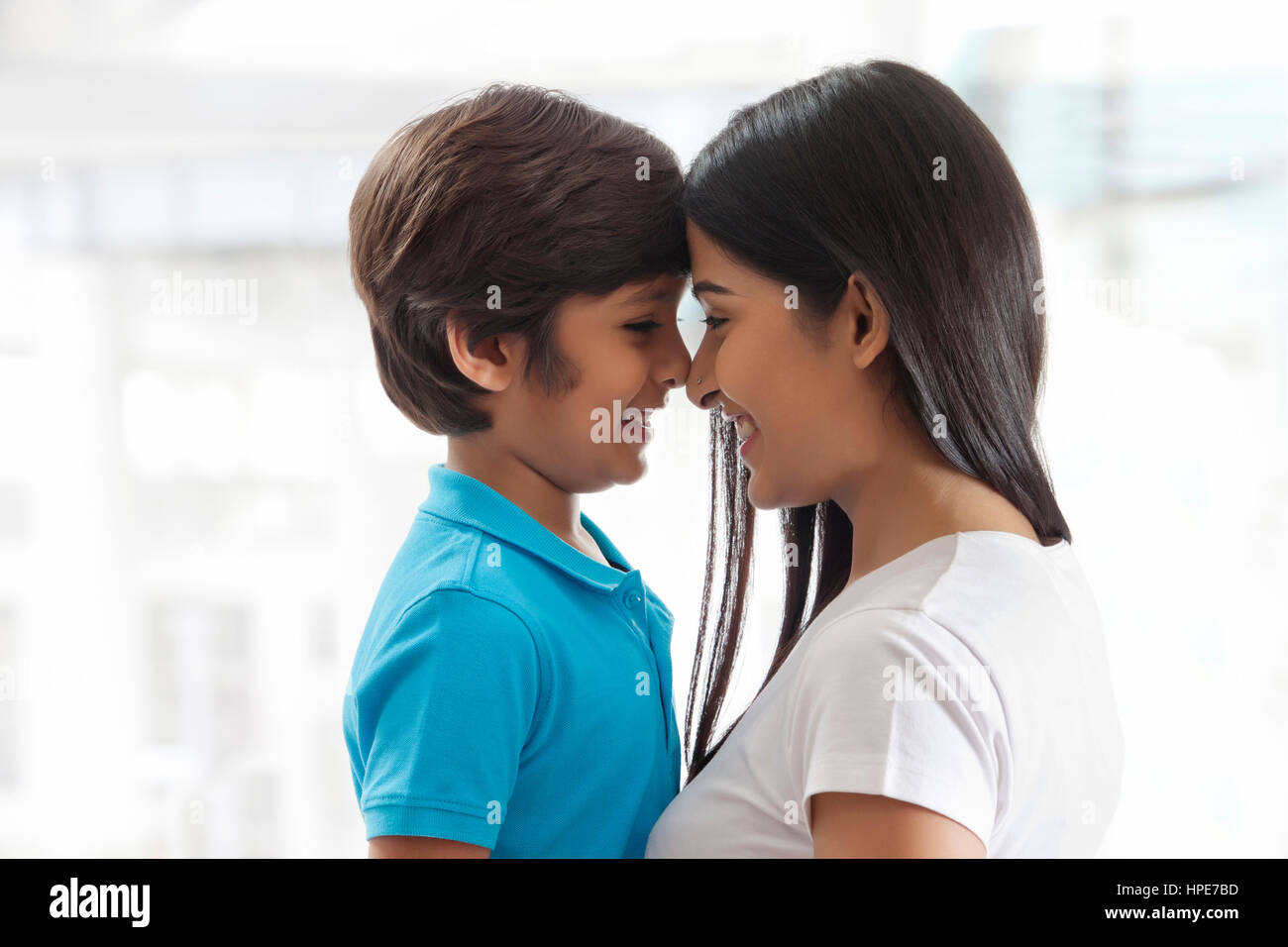 Mother and son rubbing noses together - Stock Image